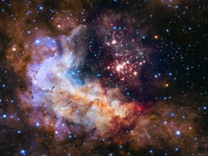 This image shows the central region of star cluster Westerlund 2 taken by the NASA/ESA Hubble Space Telescope. The image's central region, containing the star cluster, blends visible-light data taken by the Advanced Camera for Surveys and near-infrared exposures taken by the Wide Field Camera 3. The surrounding region is composed of visible-light observations taken by the Advanced Camera for Surveys. This image of the cluster and its surroundings has been released to celebrate Hubble's 25th year in orbit and a quarter of a century of new discoveries, stunning images and outstanding science.